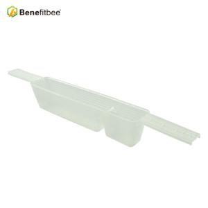 Beehive inside plastic bee feeder for beekeeping