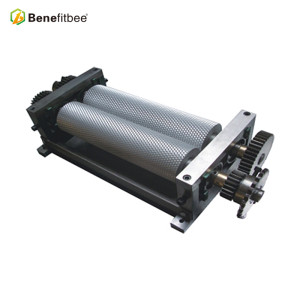 Beeswax stamping machine for making beeswax foundation