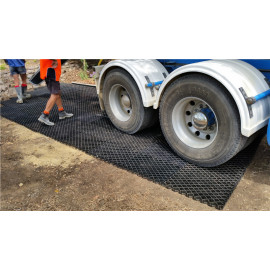 Plastic grids for planting grass muddy road drive road used