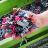 Leather and textile shredder in waste recycling