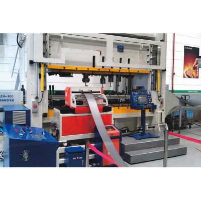 Zigzag coil feeding line and two-axis transfers in MANN+HUMMEL Oil filter production line
