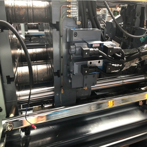 CST128/420 injection molding machine