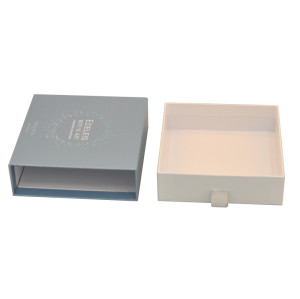 Elegant and luxury rigid cardboard cosmetic retail packaging drawer box with emboss logo