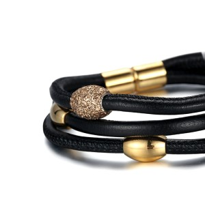 Gold mineral dust black leather stainless steel gold accessory and clasp bracelet