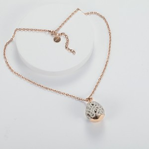 White mineral dust fligree stainless steel rose gold pendant