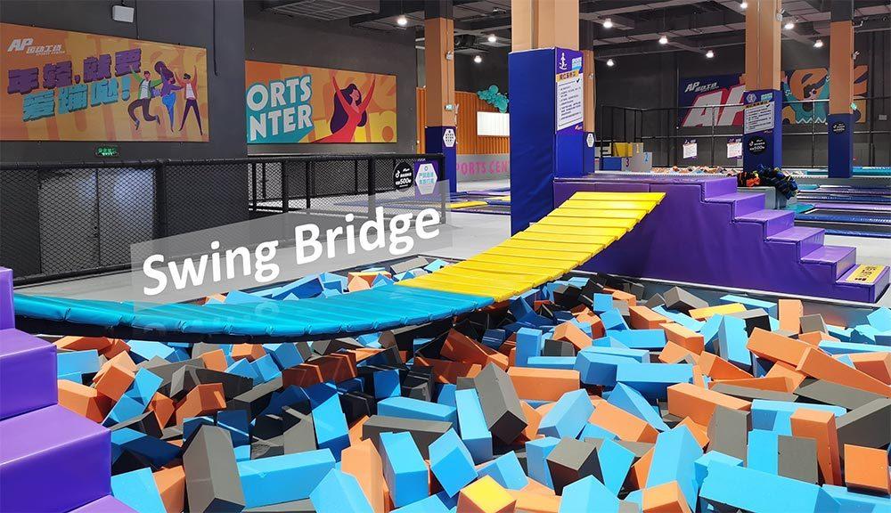 Family entertainment center trampoline park swing bridge
