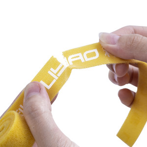 Rip-tie colored hook and loop cable tie with writable label without buckle