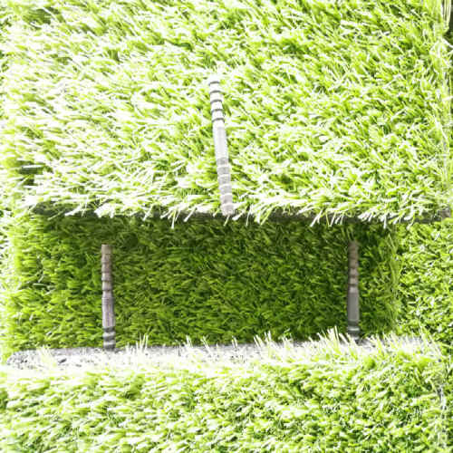Artificial grass with rubber safty tiles
