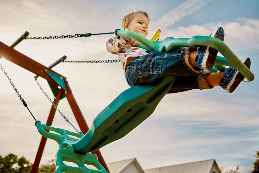 The benefits of kids swing for children's physical development.