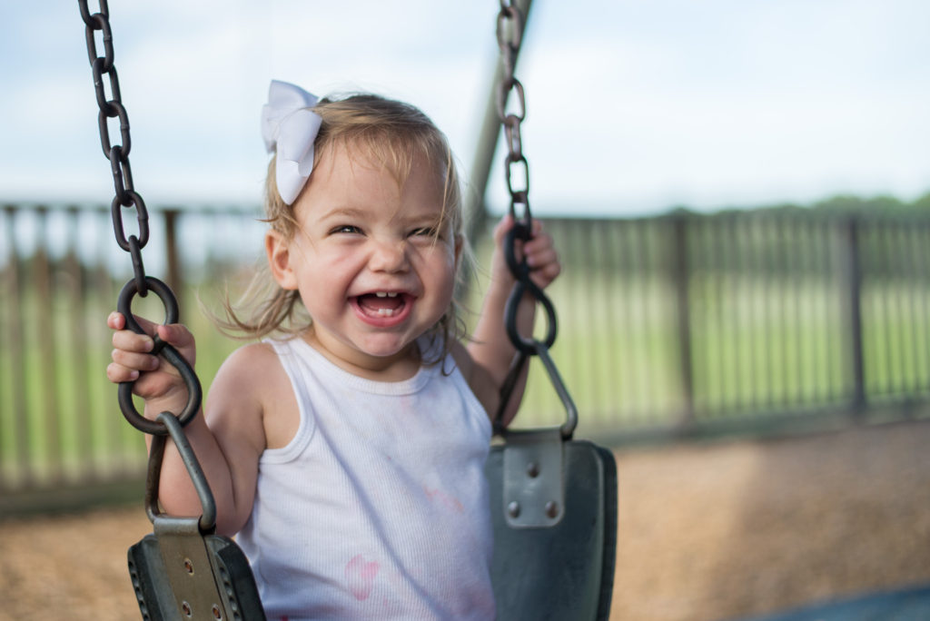 the specific benefits of children playing swings
