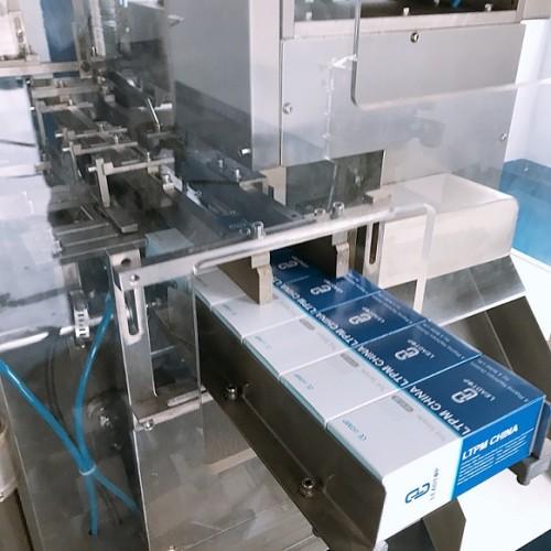 Máquina envasadora automática de cajas plegables ZH-120D para blísters y tiras