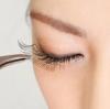 The importance of false eyelashes.