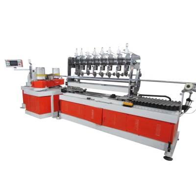 Машина для производства бумажных трубок с 2-мя головками