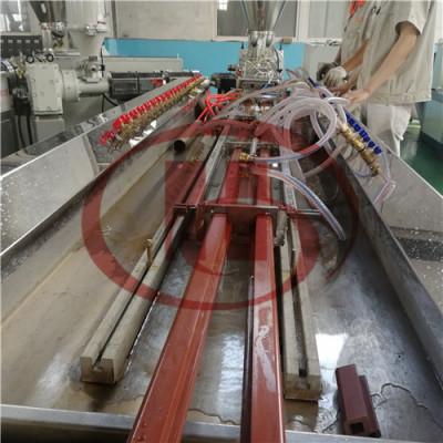 Double cavity WPC keel making machine