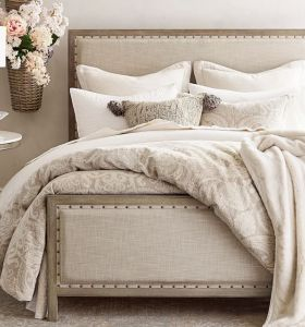 Juego de cama de tela con estructura de madera maciza lacada
