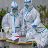 China shows best practices in virus battle, experts say