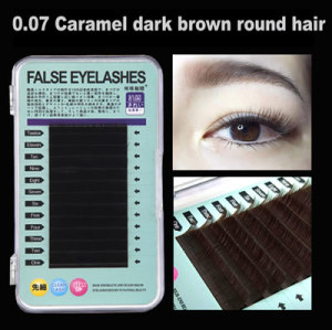Close rows of dark brown round eyelashes