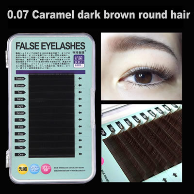 Close rows of dark brown round eyelashes