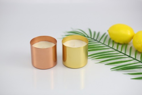 Scented soy candles in luxury metal glass jar