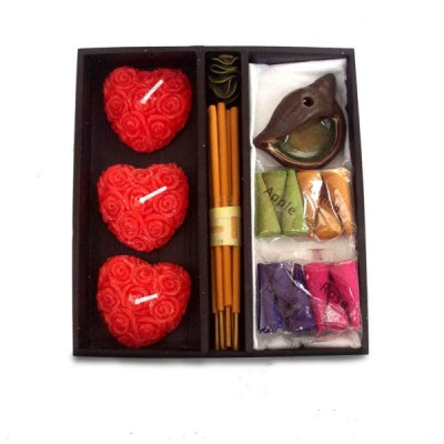 Red heart shaped candles and incense cones and sticks for gift set