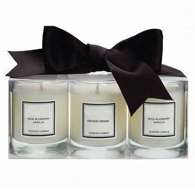 Scented soy candle in glass jar with bowknot packaging