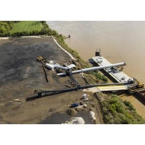 Sistema de transporte de carga y apilamiento de puertos