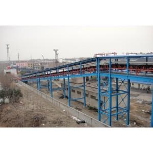 Solución de transporte de material a granel utilizando cinta transportadora tubular