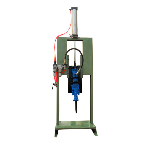Shell separator machine for removing mold shells from castings