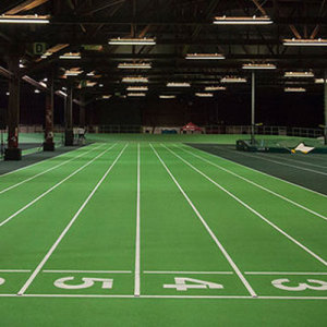 Recycled synthetic athletic track surface for rubber running track
