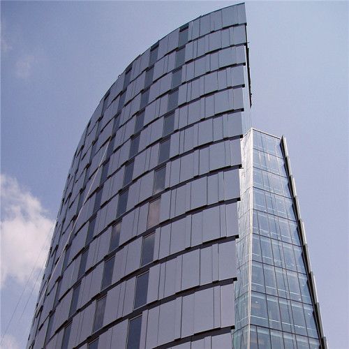 Metal - coloured aluminium veneers decorate the outer walls of office buildings