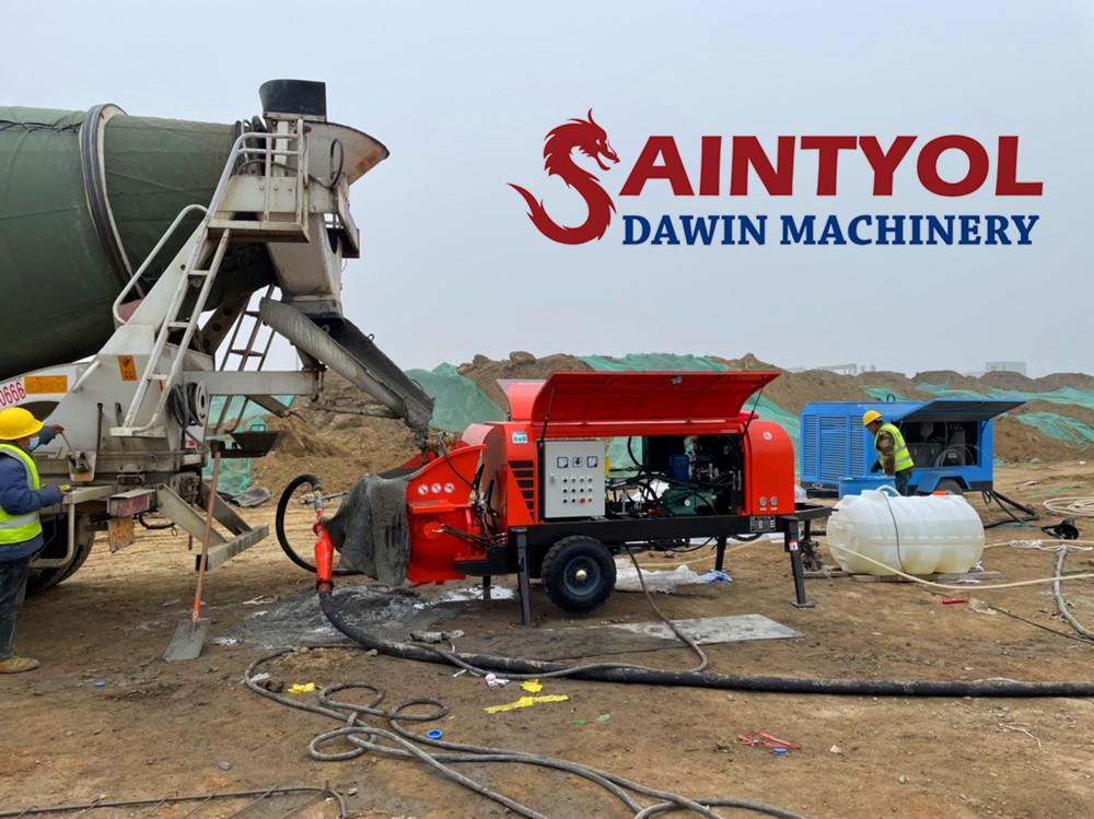 concrete pumps works on job site