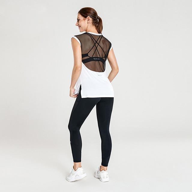 Vente en gros Vêtements de yoga avec un t-shirt ample blanc et des leggings noirs