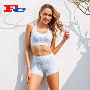 Contrasting Color Cross Straps Sports Bra And Shorts Wholesale