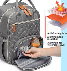 Fashionable diaper bag watertproof and stain-repellent surface diaper bag with changing station
