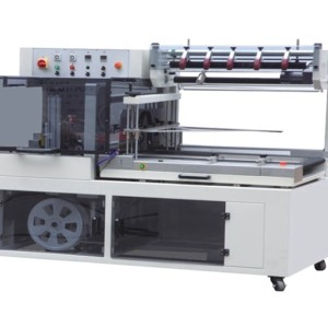 FABRIC ROLL WRAPPING MACHINE ( LINEAR FABRIC FOLDING AND PACKING LINE )