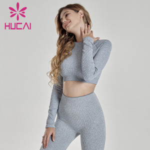 Wholesale yoga clothes long sleeve tight knit fitness suit sexy leak belly