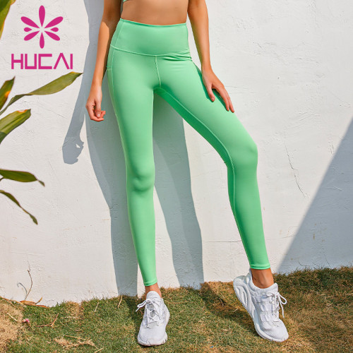 Wholesale yoga pants with pockets Side pocket High Waist Stretch fitness Capris for women