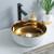 Lujoso lavabo de cerámica con encimera de color dorado de forma redonda al por mayor