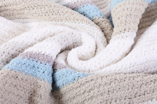 Manta tejida texturizada al por mayor del OEM con borlas del proveedor chino